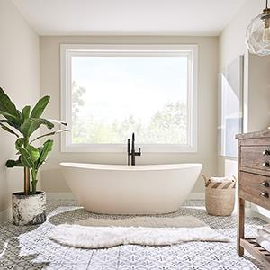 Bathtub with large vinyl window allowing plentiful light in