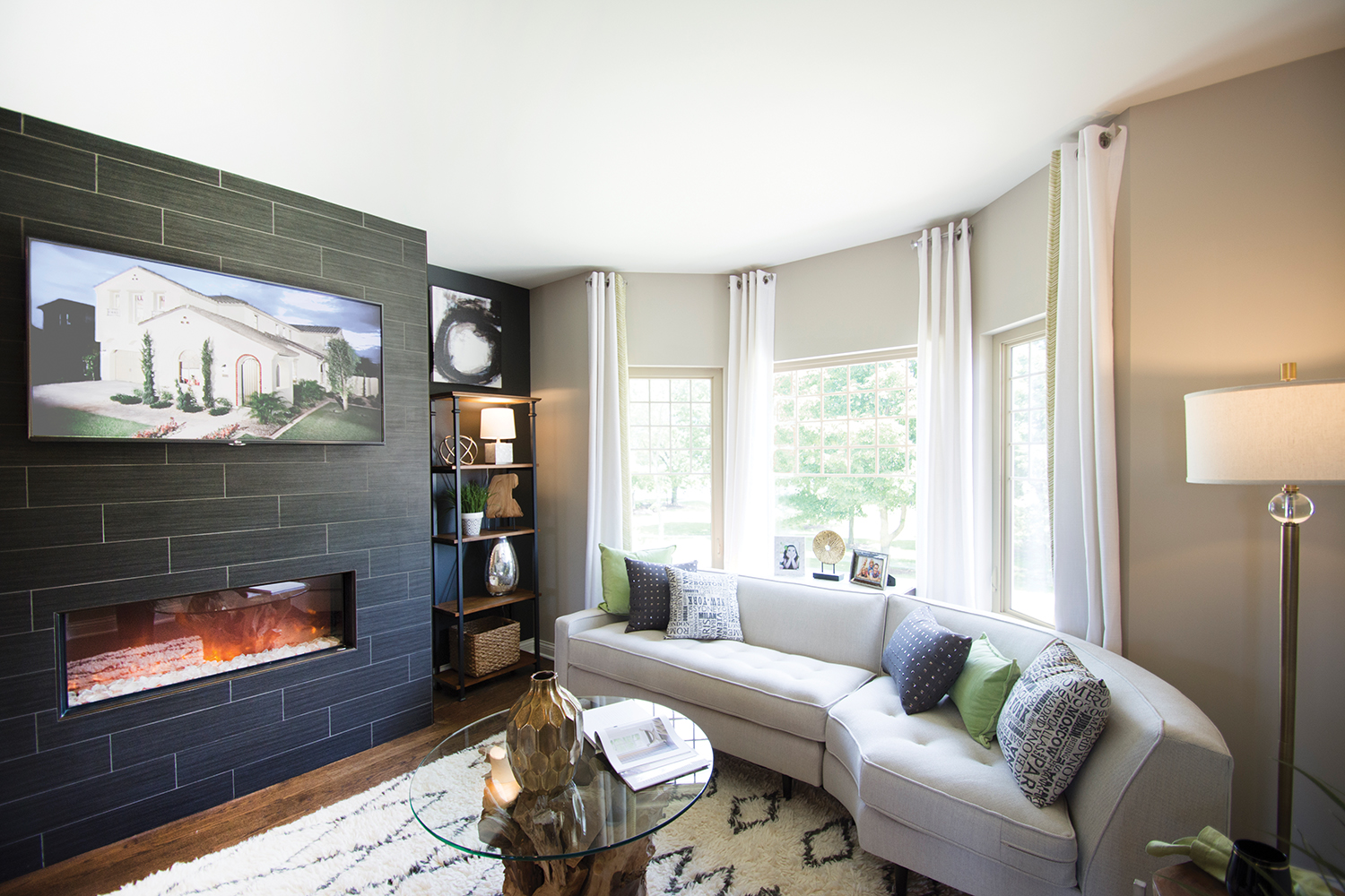 Living Room With Tv Above Fireplace In Black Slate Accent Wall