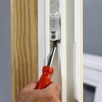 screw driver adjusting window balance